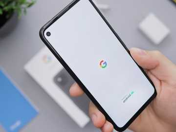person holding black android smartphone - Google Android Pixel 4a Smartphone Booting Up.