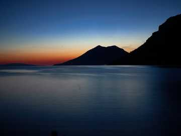 silhouette of mountain beside sea - Zuljana evenings. 