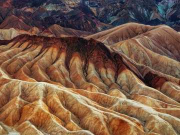 Brown fold mountains - landscape photography of brown mountains. Zabriskie Point, United States
