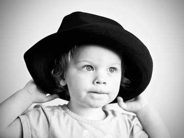 Every Day is Hat Day - grayscale photography of girl with hat.