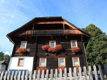 Old farmhouse - Old farmhouse with geraniums on the windows