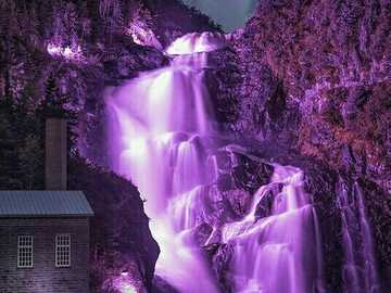 Violet waterfall with hut on rock - Violet waterfall with hut on rock