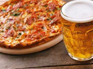 Share pizza - Sharing a pizza with beer