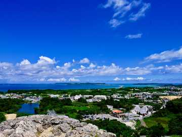 white and blue sky over city and sea during daytime - A great view from Katsuren Castle Ruins, Okinawa, Japan. Uruma, 沖縄県 日本