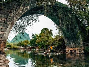 beautiful bridge - brick tunnel on the river