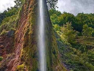A tall water fall in the Mts. - A tall water fall in the Mts. with trees