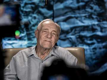 man sitting on chair - Grandpa sitting for Television. Hampton, United States