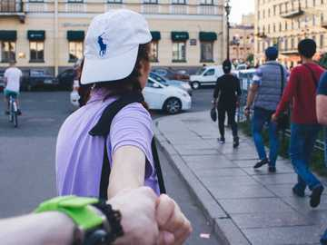 Follow Me - person holding another person's hand. Saint Petersburg, Russia