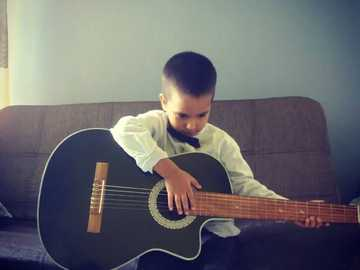 Guitar + child = victory - Etsa is the image of a boy who plays guitar