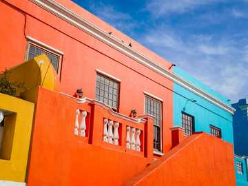Color Pop - orange and white concrete building under blue sky during daytime. Bo-Kaap, Schotsche Kloof, Cape Tow