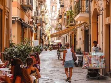 Palermo. - woman walking on street. Palermo, Italy