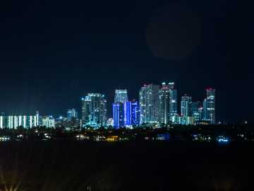 Downtown Miami, Florida - concrete buildings during nighttime. Miami, FL, USA