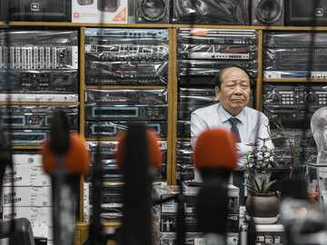 man beside stereo amplifiers - Seoul has many markets that are each a sight to behold. From all-night, underground fashion markets