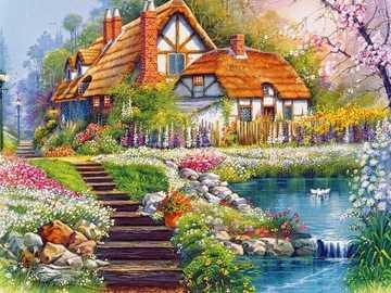 Ein schönes Haus an einem Teich, umgeben von bunten Pflanzen - Ein schönes Haus an einem Teich, umgeben von bunten Pflanzen