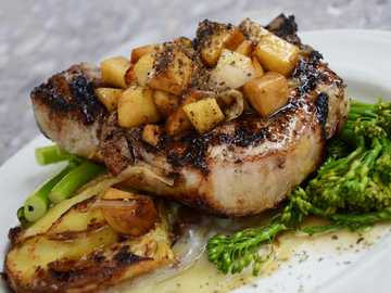 Pork Chop Dinner - grilled steak with vegetables on white ceramic plate.
