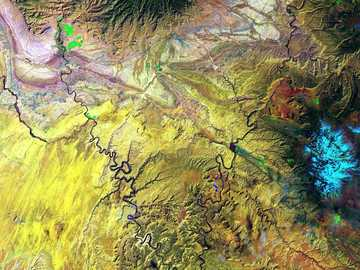 yellow green and blue abstract painting - The Green River and the Colorado River meet within Canyonlands National Park in Utah. Snow-covered M