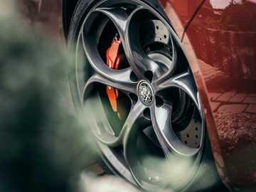 red and silver car wheel - Alfa Romeo Giulia Quadrifoglio.