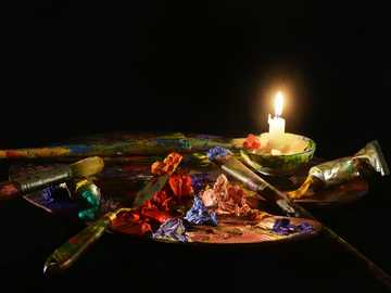 paint palette with candle - Claude Monet's favourite colours, or at least some of them. The orange on the palette knife, the p