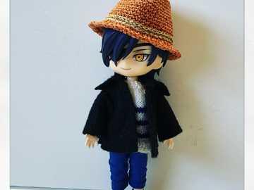 Mitsutada klädd klass - Mitsutada är elegant klädd med sin vackra hatt