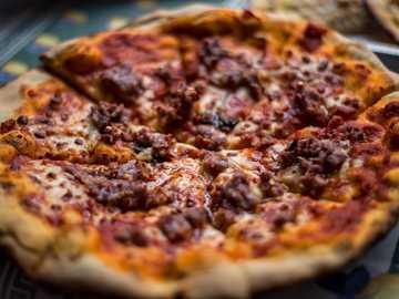 pizza with meat toppings - Traditional pizza,Diavola ! Salerno,Italy. Montecorvino Rovella, Italy