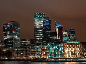city skyline during night time - View of the city of London. Long exposure at night. London Borough of Southwark, UK