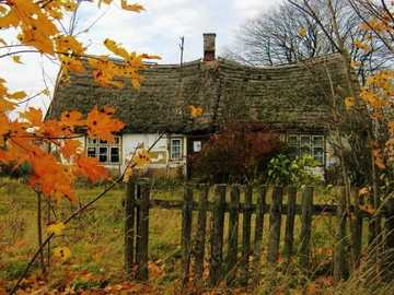 Old Cottage. Autumn - Old House Behind The Fence. .Autumn
