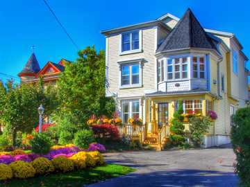 House With Flowers. - House With Colorful Flowers.
