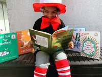 girl in red hat holding book - My Daughter for Dr.Suess week!  She loves reading and me too! .