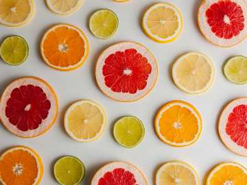 Citrus Pattern - sliced orange fruit on white surface. São Paulo, Brazil