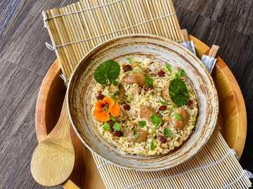 Nasi Goreng - Asian food - soup dish in brown ceramic bowl.