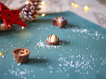 Chocolate, Bob Bon, Christmas, Food, Haarlem - brown and white heart shaped cookies on blue textile.