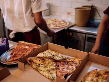 @ Pizza Place - person in white shirt holding pizza. Jakarta Selatan, South Jakarta City, Jakarta, Indonesia