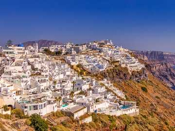 Santorini - white and brown concrete buildings on hill during daytime. Santorini, Santoryn, Grecja