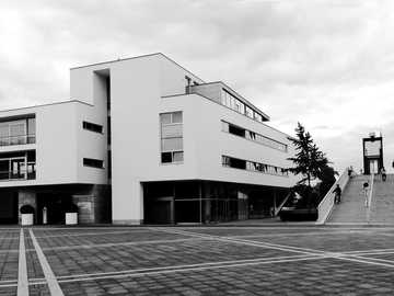 grayscale photo of house - The square is named after the important year for Maastricht in 1992, when the Treaty of Maastricht w
