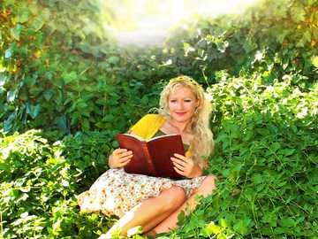 I Come To The Garden Alone - woman in yellow dress sitting on green grass field.