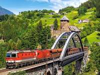train on the bridge in the mountains - m .....................