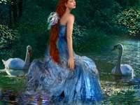 woman- in the background a river with swans - m ........................