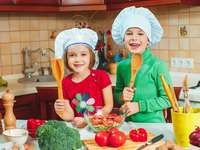 children are cooking in the kitchen