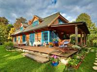 wooden house with blue shutters - m .....................