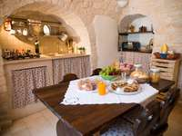 Traditional trulli house inside in Apulia - Traditional trulli house inside in Apulia