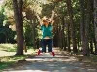 Jump in the Jungle - woman taking jump selfie. Atatürk Arboretumu, Turkey