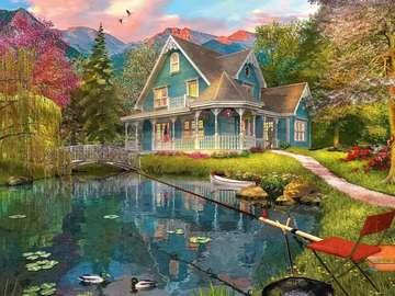 dom w górach przy jeziorze