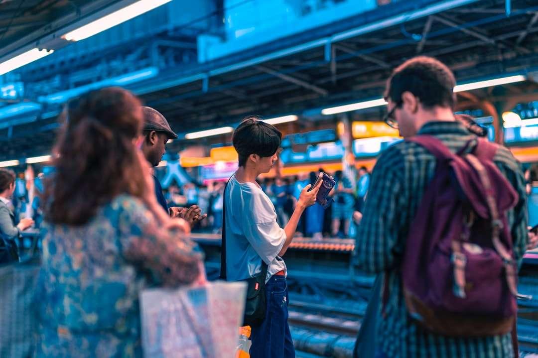 Cell Boy - people waiting train at daytime. Harajuku Station, Shibuya-ku, Japan (9×6)