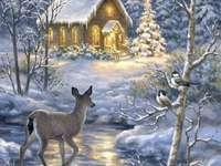 Vinterlandskapskyrka och rådjur