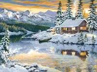 Casa in riva al lago nel paesaggio invernale
