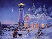 House and lighthouse in winter