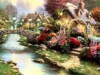 Casinha à beira do rio entre flores