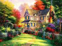 A casa é cercada por flores coloridas