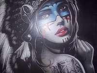 Apache woman - A woman posing in Apache dress