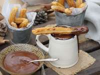 Churros with chocolate - Eat churros with chocolate.